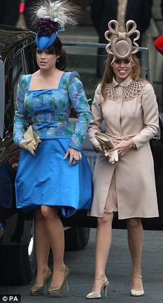 Princess Eugenie, blue dress, and Princess Beatrice arrive at Westminster Abbey for their cousin William's wedding.
