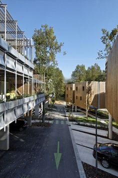 Image 12 of 27 from gallery of Collective Eco-Housing La Canopée / Patrick Arotcharen Architecte. Photograph by Vincent Monthiers Landscape Architecture, Architecture Design, Co Housing, Timber Cabin, Farm Stay, Built Environment, Science Nature, Street View, Gallery