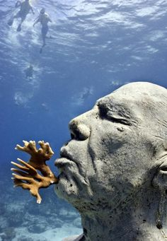Explore an underwater museum. Cancun, Mexico.