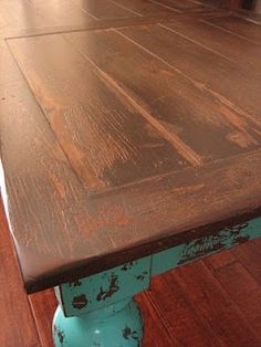 Rustic turquoise dining table made out of old door....