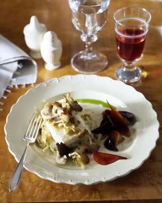 This dish may look complicated, but it's really quite simple: Place halibut fillets atop a bed of sauteed leeks and shallots, sprinkle with sauteed mushrooms, and roast. Serve drizzled with chive oil, alongside a colorful beet salad.
