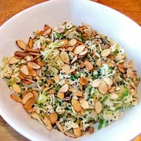 Coleslaw Crunch Salad, Sue made this for our sleep over and it was yummy!  3/4 cup salad oil  1/3 cup sugar  1/3 cup white vinegar  2- 2.8 oz packages beef flavored Ramen Noodles  1 16 oz pkg shredded cabbage with carrots coleslaw mix (about 8 cups)  1 cup slivered almonds, toasted  2 medium carrots, shredded (1 cup)  1/2 cup sliced green onions  1/2 cup shelled sunflower seeds