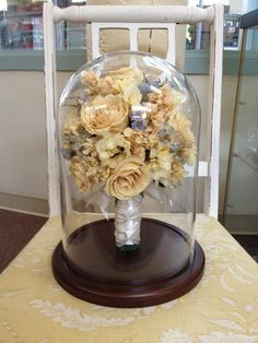 Bridal Bouquet preserved flowers are dried and placed in a lovely glass dome $499