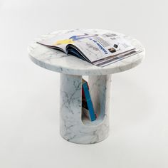 U-Turn Sculptural Side Table with Storage Space for Magazines http://www.covo-shop.com/product_info.php/products_id/272 Read more: 11 Stylish Versatile Magazin Tables http://vurni.com/magazin-tables/