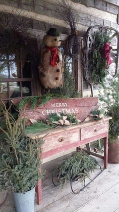 Weathered old things, that may have otherwise been discarded, come together to make a lovely, rustic, country Christmas display.