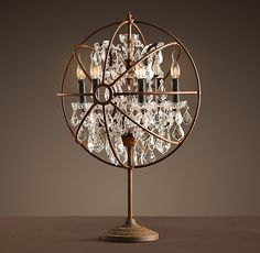 I have this table lamp in the living room area adjacent to my dining area complimenting the Folcault's orb chandelier.