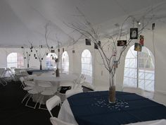 DIY centerpieces: spray painted tree branches and hanging photos.