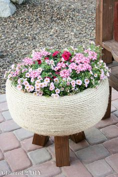 Addicted 2 DIY blogger Katie dreamed up this brilliant idea of turning an old tire into a planter by wrapping it in sisal rope and adding legs.