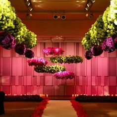 Floral artist to the stars Jeff Leatham created these floating floral arrangements for a thoroughly modern indoor ceremony.