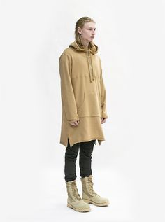 Full body side angle image of Elongated Hooded Pullover Trench in Khaki on model