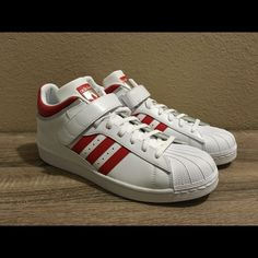 separation shoes 593e9 0a039 Shop Men s adidas Red White size 11 Sneakers at a discounted price at  Poshmark. Description  Pro shell Adidas with red stripes.