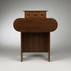 ETTORE SOTTSASS    Barbarella cabinet    Poltonova  Italy, 1966  Italian walnut, brass  42 w x 16.25 d x 50 h inches  Symmetrical form with drop front writing surface below three drawers.