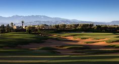 15th green Royal Palm Golf Course Marrakech, challenging Par 4 with the Atlas Mountains in the background