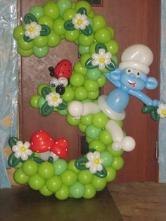 3º aniversário com o tema smurfs em balões www.partyland.pt