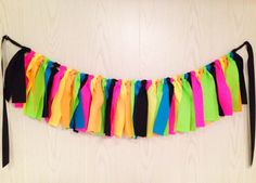 Neon Party Fabric Tie Garland   $29 at http://shop.thepartyteacher.com/products/neon-party-fabric-tie-garland