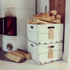 Old milk bottle boxes used as storage for wood love
