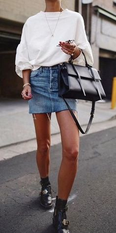 sweatshirt. denim skirt. buckle boots. street style.