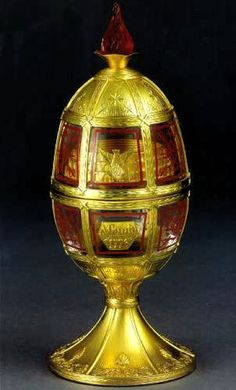 "(3) FABERGE eggs__Theo Faberge - ""'Centennial Olympic Games"""" Egg The surprise is the sterling arena where all the athletes come together, inset is the likeness of the 1896 winner's medal, a symbol of excellence and achievement."