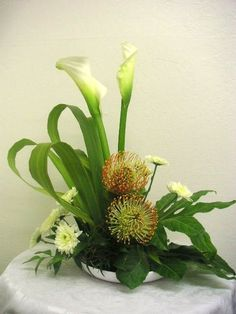 If you want to learn a variety of floral designs from European arrangement to Japanese Ikebana, wedding to funeral decorations AND beginner to professional levels, we an help. Description from examiner.com. I searched for this on bing.com/images