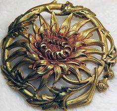 Large Antique Openwork Metal Sunflower Button. different than preceding button (irregular rim)