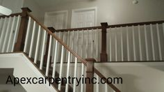 Hickory railing with white square balusters built in Taylorsville Utah