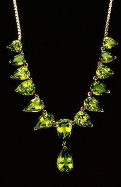 The yellow gold necklace is set with 14 pear-shaped faceted tsavorite garnets (rare and very prized brilliant green). They have a total weight of 30.79 carats and are a beautiful medium yellowish-green color. The tsavorites graduate in size and are very well-matched.