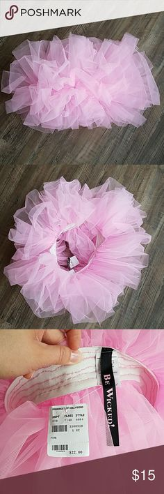 Pink tutu Never worn pink tutu.  Bought it for Halloween and never wore It! Frederick's of Hollywood Other