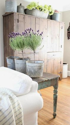 Love the lavender in the buckets and this gorgeous cupboard