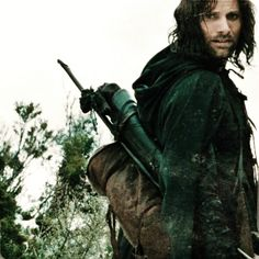 """""""The Man......was he from Gondor?"""" """"No, from the North. One of the Dunedain Rangers, I thought he was. His cloth was poor. And yet he bore a strange ring; Two serpents with emerald eyes..  One devouring, the other crowned with golden flowers."""" """"The Ring of Barahir. So Gandalf Greyhame thinks he has found lsildur's heir. The lost king of Gondor."""""""