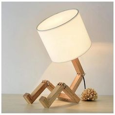 Item Type: Table Lamps Introducing The Modern Robot Lamp! This premium item is guaranteed to catch eyes at all times. THE MODERN ROBOT LAMP! Wooden Table Lamps, Rustic Lamps, Bedside Table Lamps, Bedroom Lamps, Bed Lamps, Lamp Table, Floor Lamps, Desk Light, Lamp Light