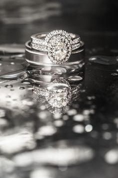 Oval Halo Diamond Ring with Bands | Photography: Style & Story Creative. Read More:  http://www.insideweddings.com/weddings/catholic-ceremony-romantic-modern-outdoor-wedding-reception/851/