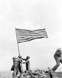 U.S. Marines of the 28th Regiment of the Fifth Division raise the American flag after capturing the 550-foot Mt. Suribachi on Iwo Jima, the largest Volcano Islands of Japan, on Feb. 23, 1945 during World War II. (AP Photo/Joe Rosenthal). After 70 years, Iwo Jima flag debate still simmers | NewsCut | Minnesota Public Radio News