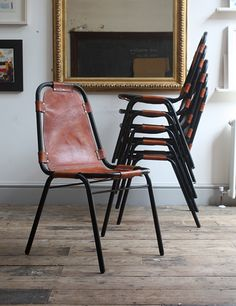 Charlotte Perriand; Leather and Enameled Metal 'Les Arcs' Stacking Chairs, 1960s.