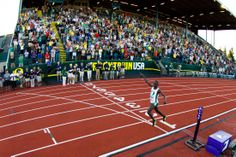 Oregon freshman Edward Cheserek crosses the finish line after finishing first in the men's 10,000 meter run. Cheserek finished with a time o...