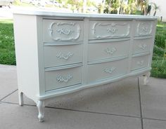 White dresser. Could add embellishments to mine before painting?