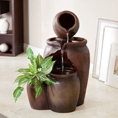 The Tolleson Fountain is more than just a fountain - it's a centerpiece that ties your entire room together. The Tolleson is a lighted fountain that features a trio of rustic pots, constructed from durable resin and fiberglass for indoor or outdoor use. The fourth pot that sits next to the others is designed to be a planter, perfectly sized for a small plant.