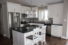 LOVE this kitchen!! This guy does a SUPERB job!! Shaker style kichen with Cloud White finish