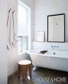 A clawfoot tub anchors the cottage-inspired bathroom. | Photographer: Angus Fergusson Designer: Mazen El-Abdallah
