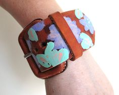 Hand painted leather hippie cuff flowerpower  womens by So cliché jewelry  https://www.facebook.com/soclichejewelry