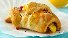 Bacon, Egg & Cheese Breakfast Sandwiches: Breakfast ready in 30 minutes! Crescent shape sandwiches filled with bacon, egg and cheese made using Pillsbury® dinner rolls. Yummmmm