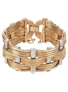 1950's gold-tone bracelet from Rewind Vintage Affairs featuring a woven design, diamanté accents and a snap fastening.