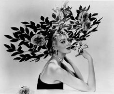 Model Carmen Dell'Orefice (at 25) wearing a hat by Mr. John for Stars and Society | 1956