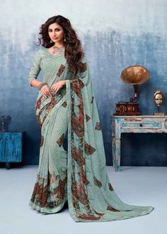 Buy indian designer sarees online for all occasions. Grab this distinctive faux georgette printed saree Indian Designer Sarees, Latest Designer Sarees, Latest Sarees, Saree Sale, Celebrity Gowns, Trendy Sarees, Green Saree, Casual Saree, Georgette Sarees