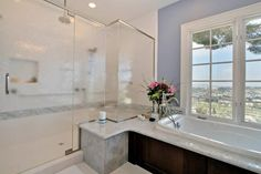 Kick+back+and+do+some+serious+relaxing+in+this+bathroom's+luxurious+soaking+tub,+perfectly+positioned+to+take+in+the+sweeping+landscape+views.
