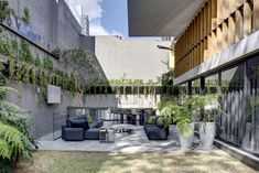 Spacious concrete residence located in Mexico City, Mexico, designed by RIMA Arquitectura. Outdoor Spaces, Indoor Outdoor, Steel Columns, Exposed Concrete, Concrete Design, Building Materials, Mexico City, Pathways, Ground Floor