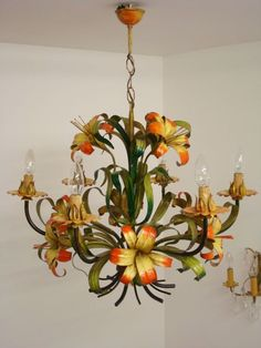 lovely light in the right place.not an orange yellow person Lamp Light, Toleware, Flower Chandelier, Lamp, Light, Painted Chandelier, Italian Chandelier, Happy Lights, Chandelier Lighting