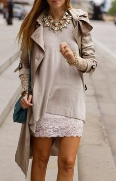 lace peeking out of sleeves w asymmetrical sweater and statement necklace