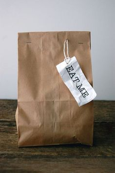 brown paper bag + packaging. A great way to do Clearance! surprise bags!! :)