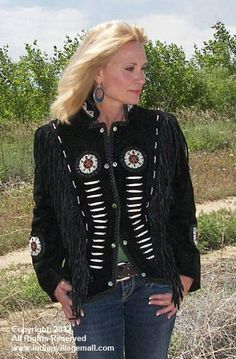 Silro Cowgirl Indian Bone Black Jacket  Ladies black suede jacket with snap closure, ruby1 style with additional silver beads along bone beads. Jacket has hand sewn beaded medallions and a snap closure. -Review off of: http://www.indianvillagemall.com/ladyblackbone.html