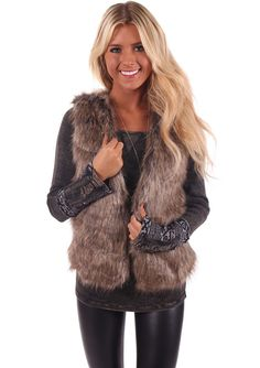 Lime Lush Boutique - Sleeveless Fur Vest With Waist Belt, $74.99 (http://www.limelush.com/sleeveless-fur-vest-with-waist-belt/)